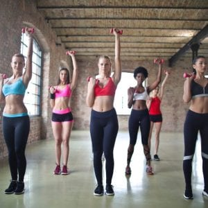 women exercising in the gym space