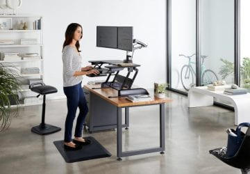 Woman standing at a desk