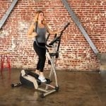 Worman exercising with Elliptical