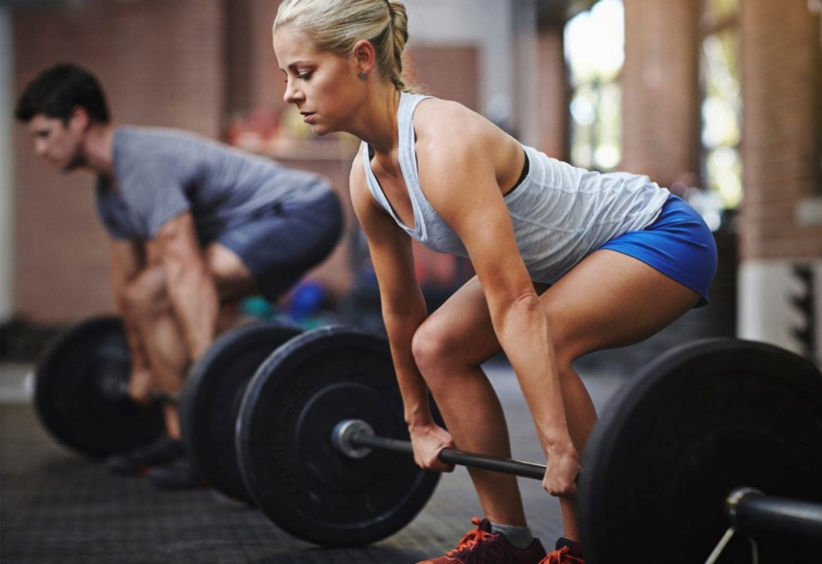 Man and woman doing deadlifts