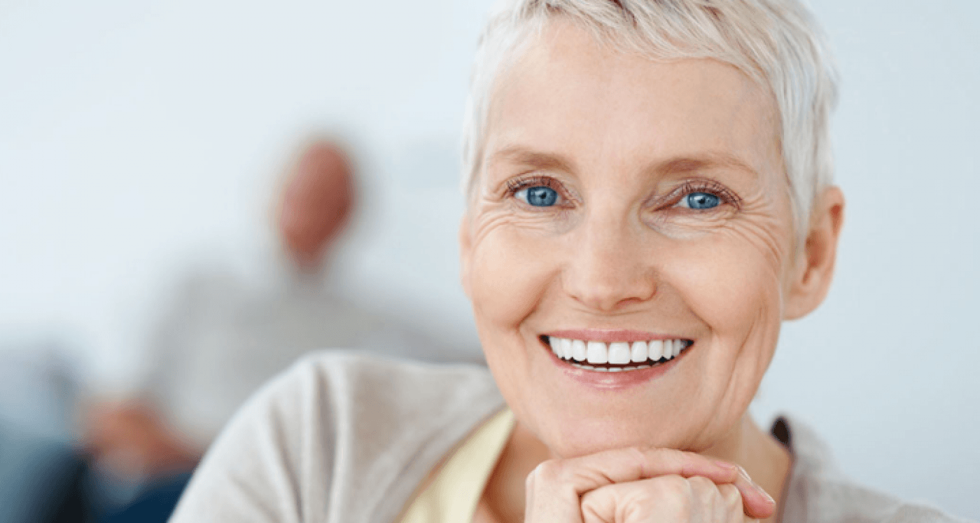 senior lady in the foreground with a healthy smile