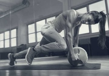 womon doing exercise on the floor with an exercise ball