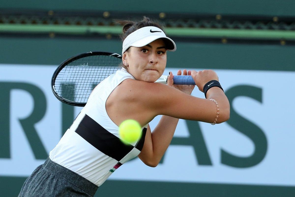 Canadian tennis player hitting a ball