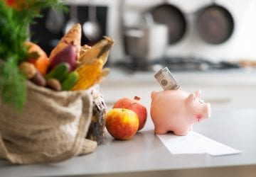 piggy bank in front of healthy food