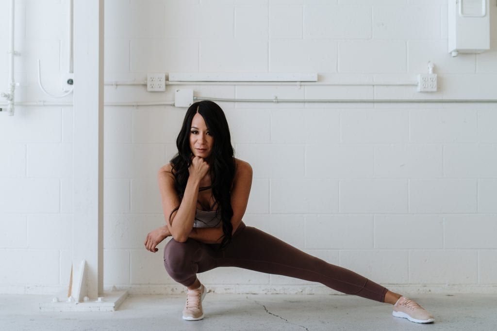 woman stretching in yoga gear