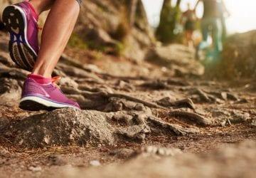 woman running on a muddy trail