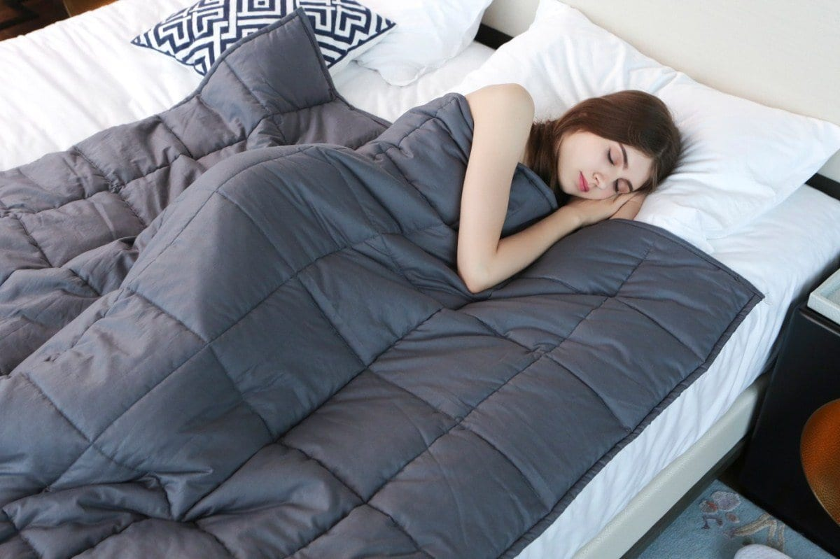 Lady sleeping with weighted blanket