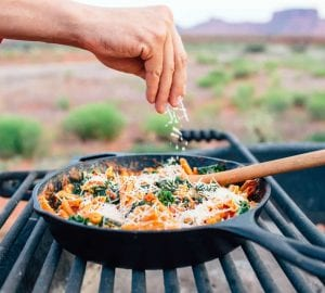 cooking a meal on a camp stove