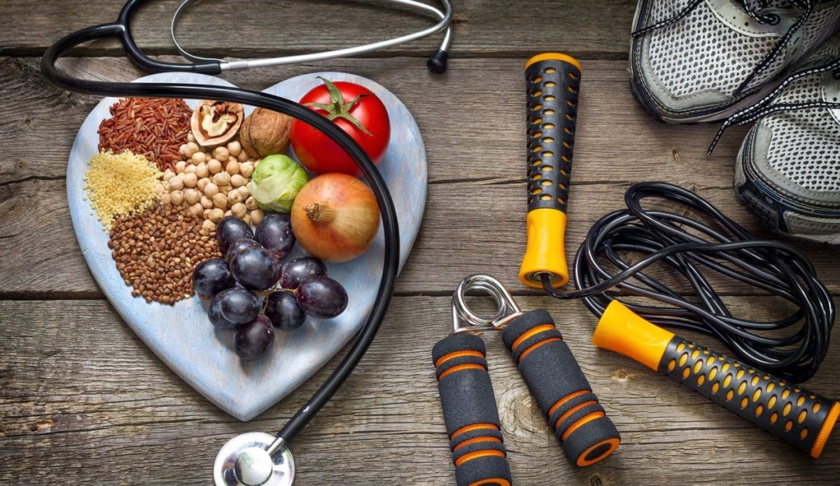 healthy food and exercise equipment on a table