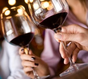 couple enjoying a glass of red wine