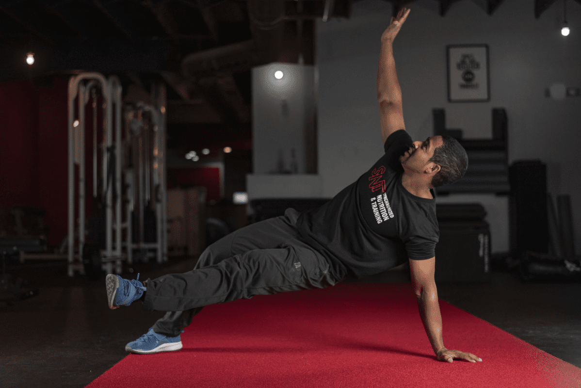 man doing exercises on the floor