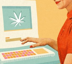 woman sitting in front of a computer ordering CBD