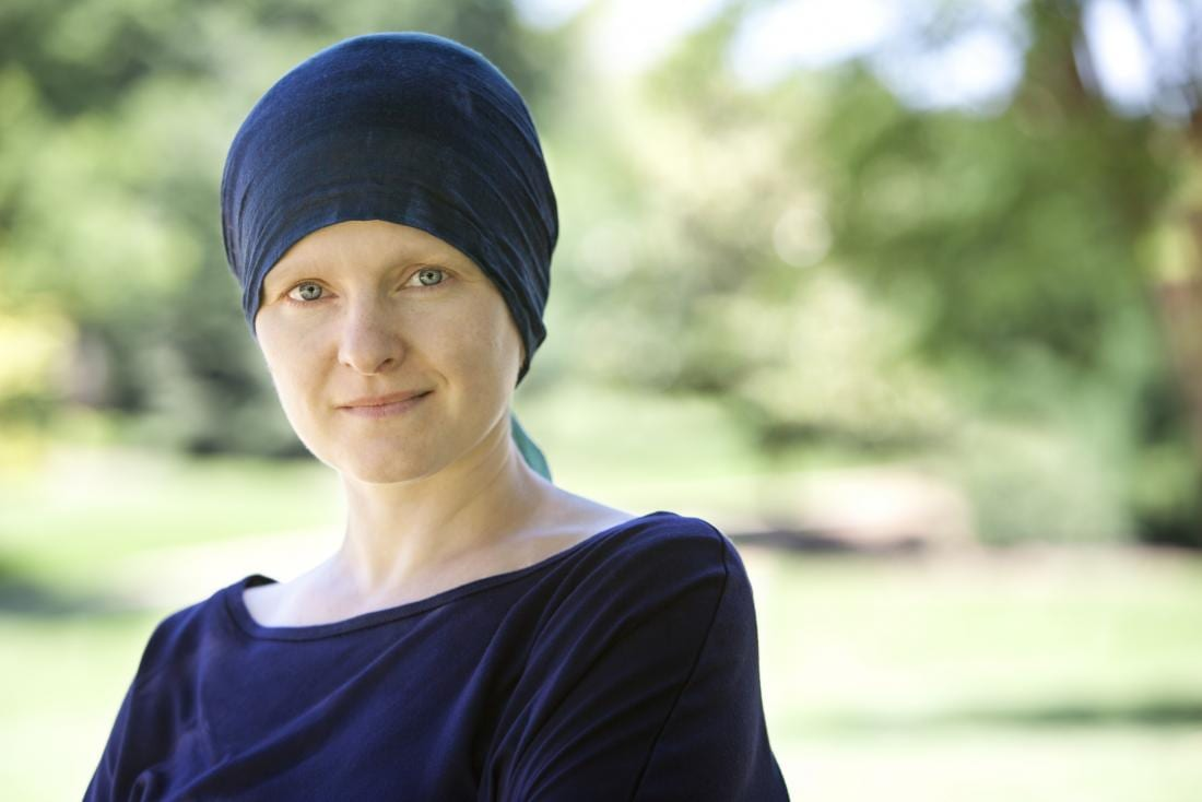 woman with cancer wearing a headband