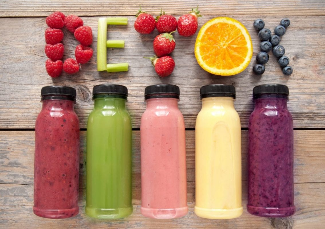 bottles of fresh juice with the word detox