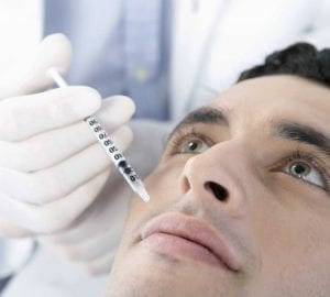 man getting lip injections