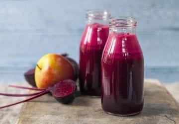 fruits and vegetables beside juice bottled