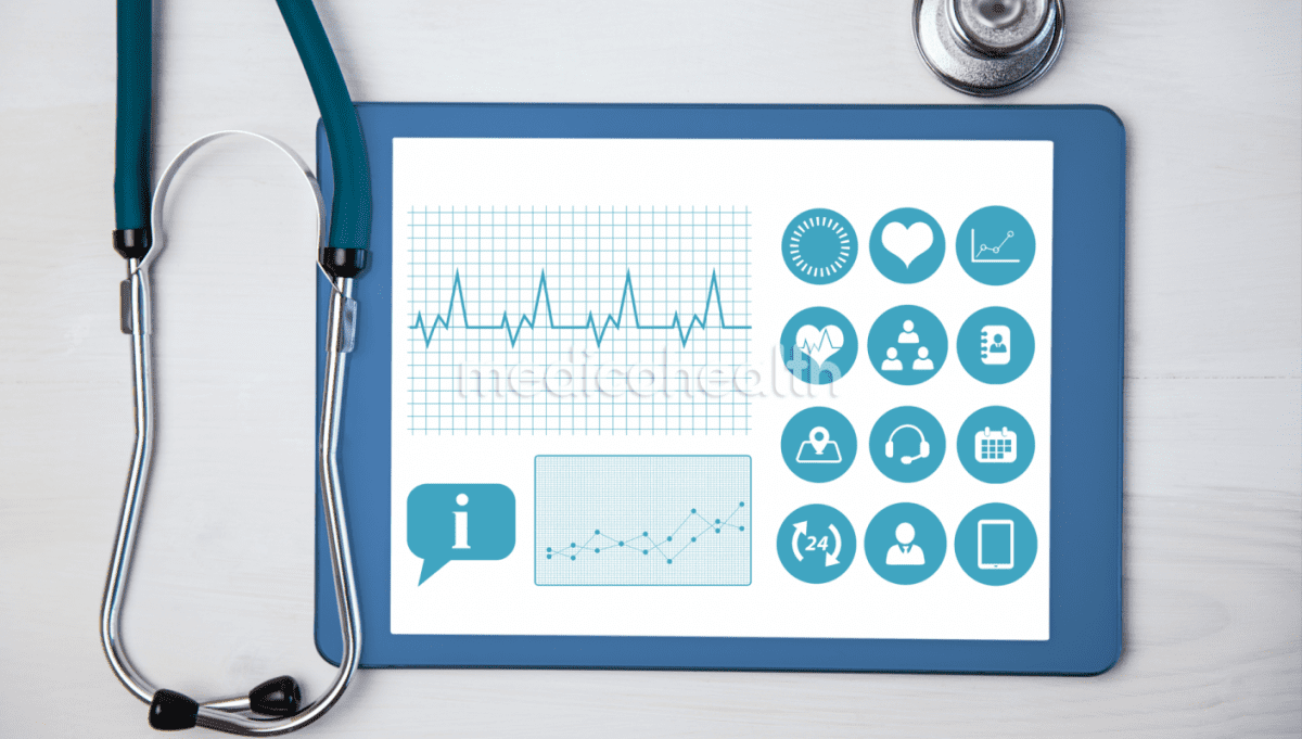 stethoscope beside a tablet showing health information