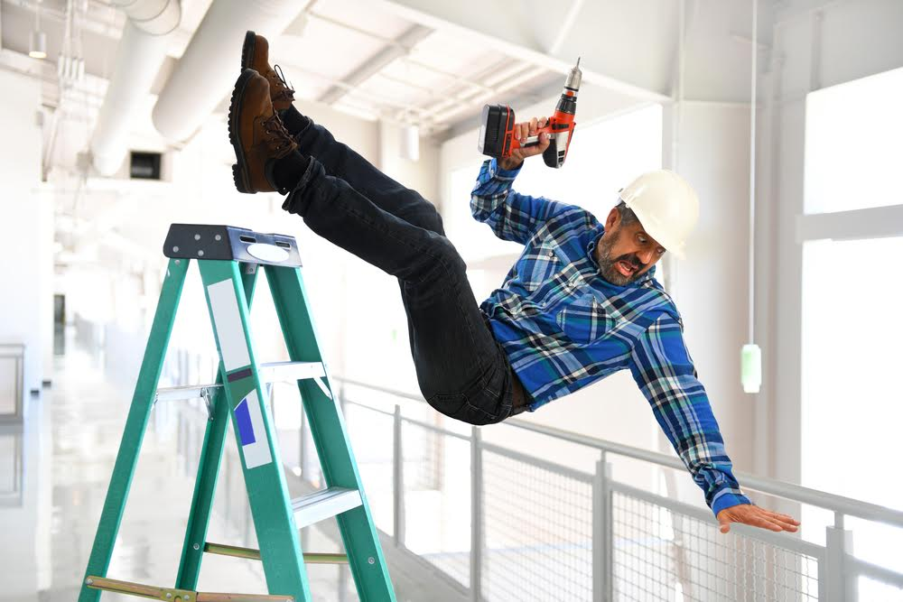 man falling off a ladder at work