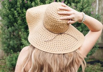 woman wearing a big hat outdoors in the summer