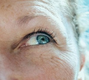 older woman with close up of her eyes