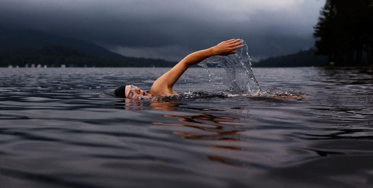 person swimming in a lake.