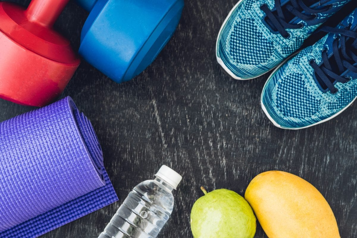 fitness items placed on a workout mat