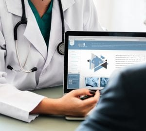 doctor reviewing a website with their patient