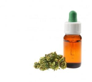 cbd oil next to a small amount of cannabis