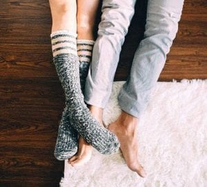 legs of a couple who are lying on the floor