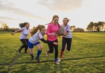 a group of girls playing rugby