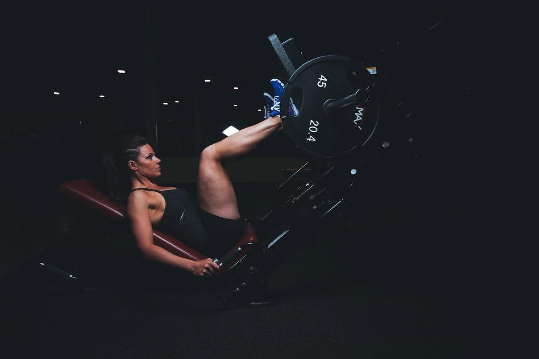 woman doing leg press exercises