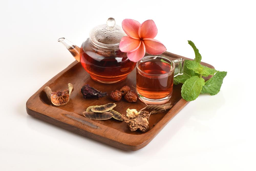 a colourful table with tea