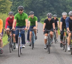a group of adults riding bikes