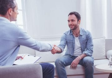 person shaking hands with their counsellor