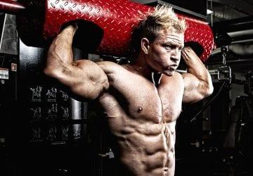 muscular man doing shoulder exercises