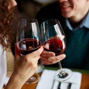 a couple enjoying a glass of red wine