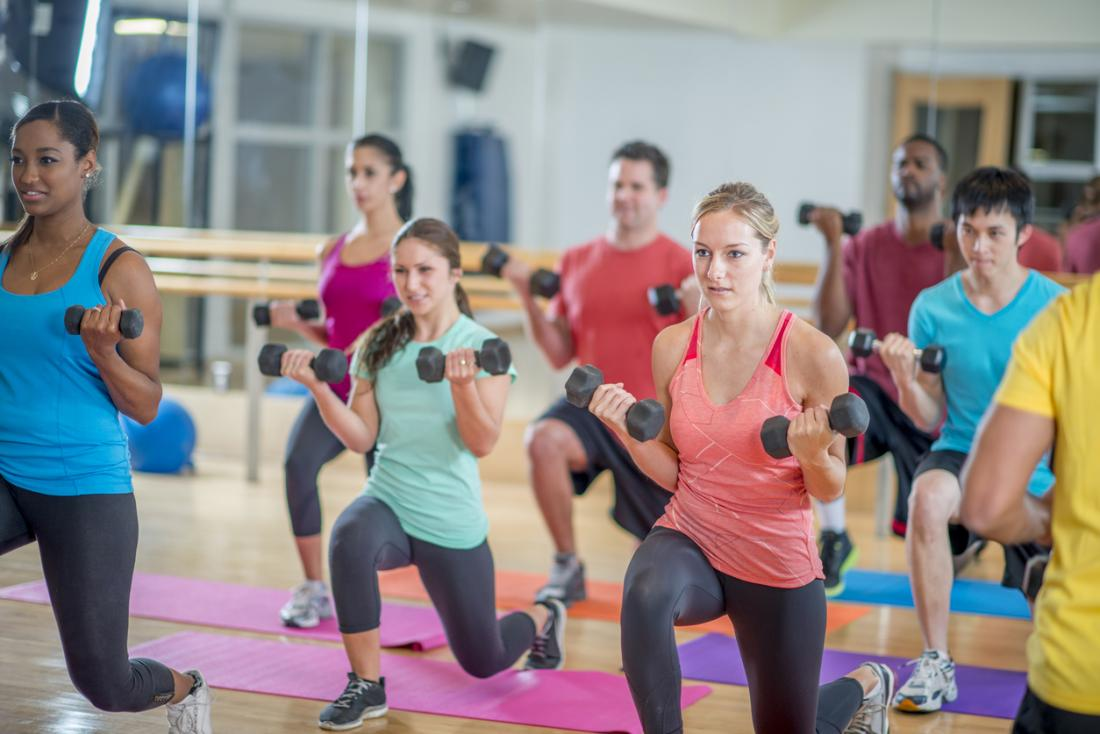 young adults exercising in a group class