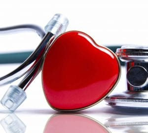 a heart sitting beside a stethoscope