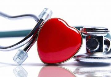 a heart sitting beside a stethoscope