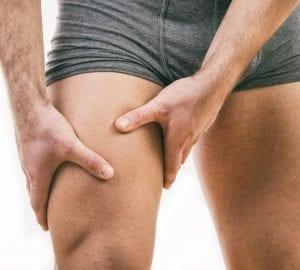 man applying a massage to his leg