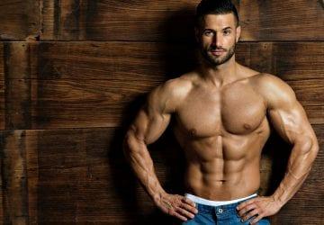 muscular man posing without a shirt