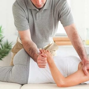 chiropractor aligning a womans spine