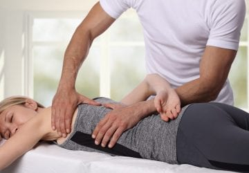 woman getting seen by a chiropractor