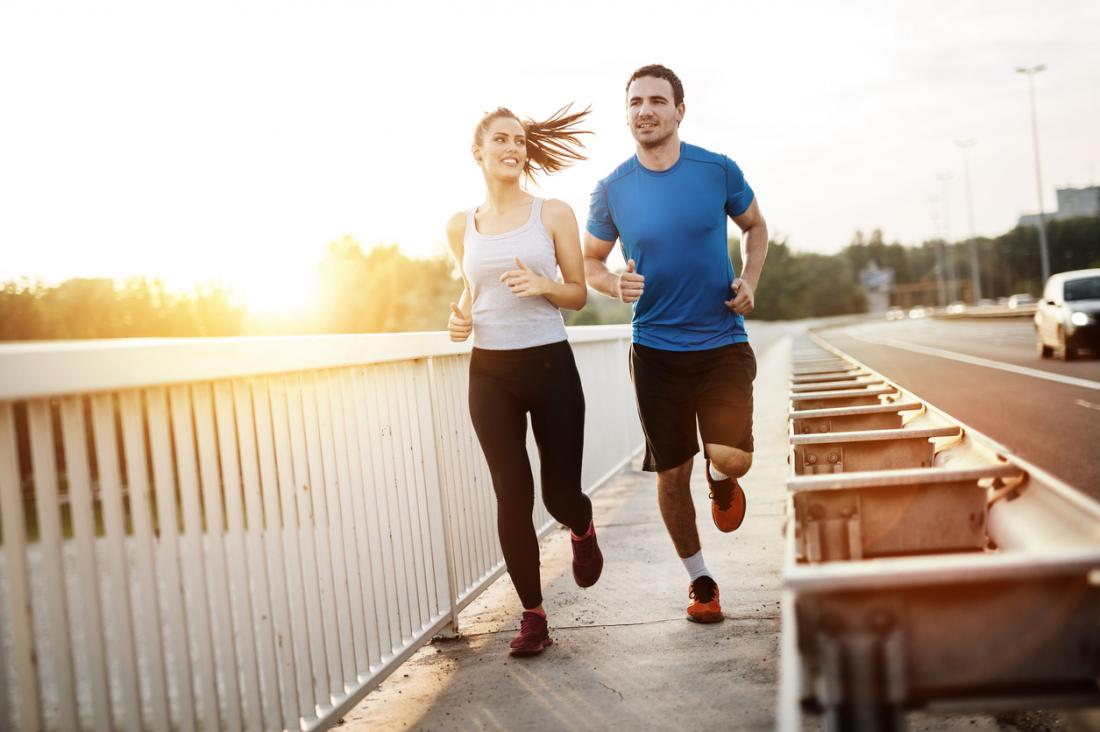 a couple going for a run outdoors