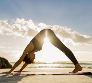 woman doing downward dog yoga position