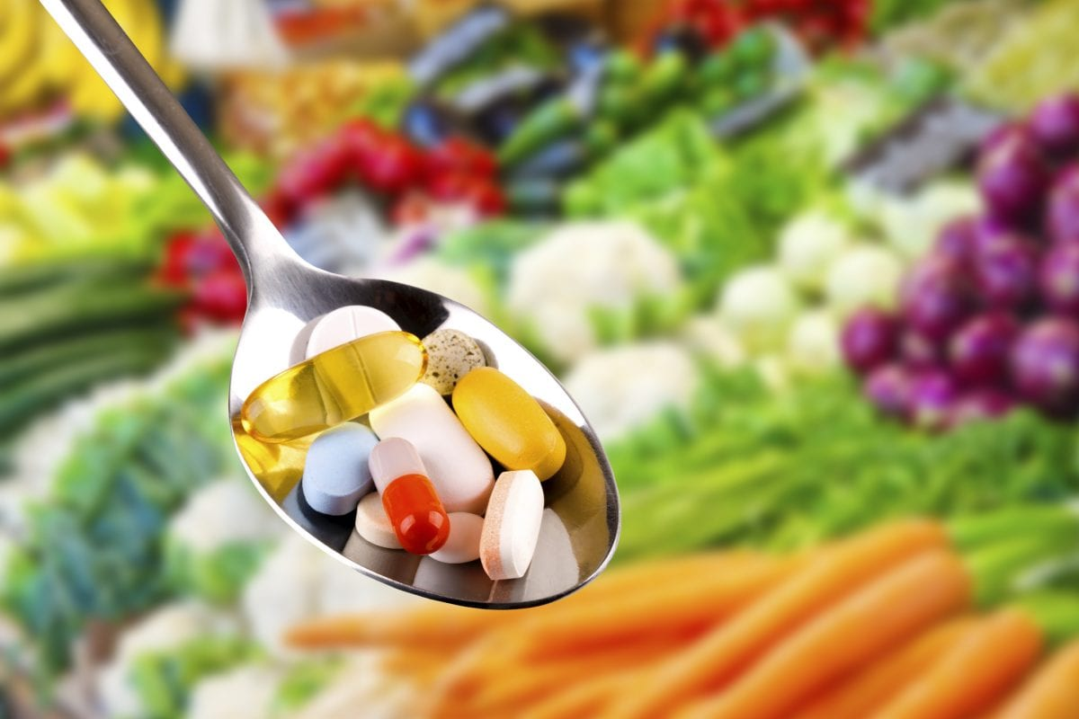 spoon with vitamins and supplements