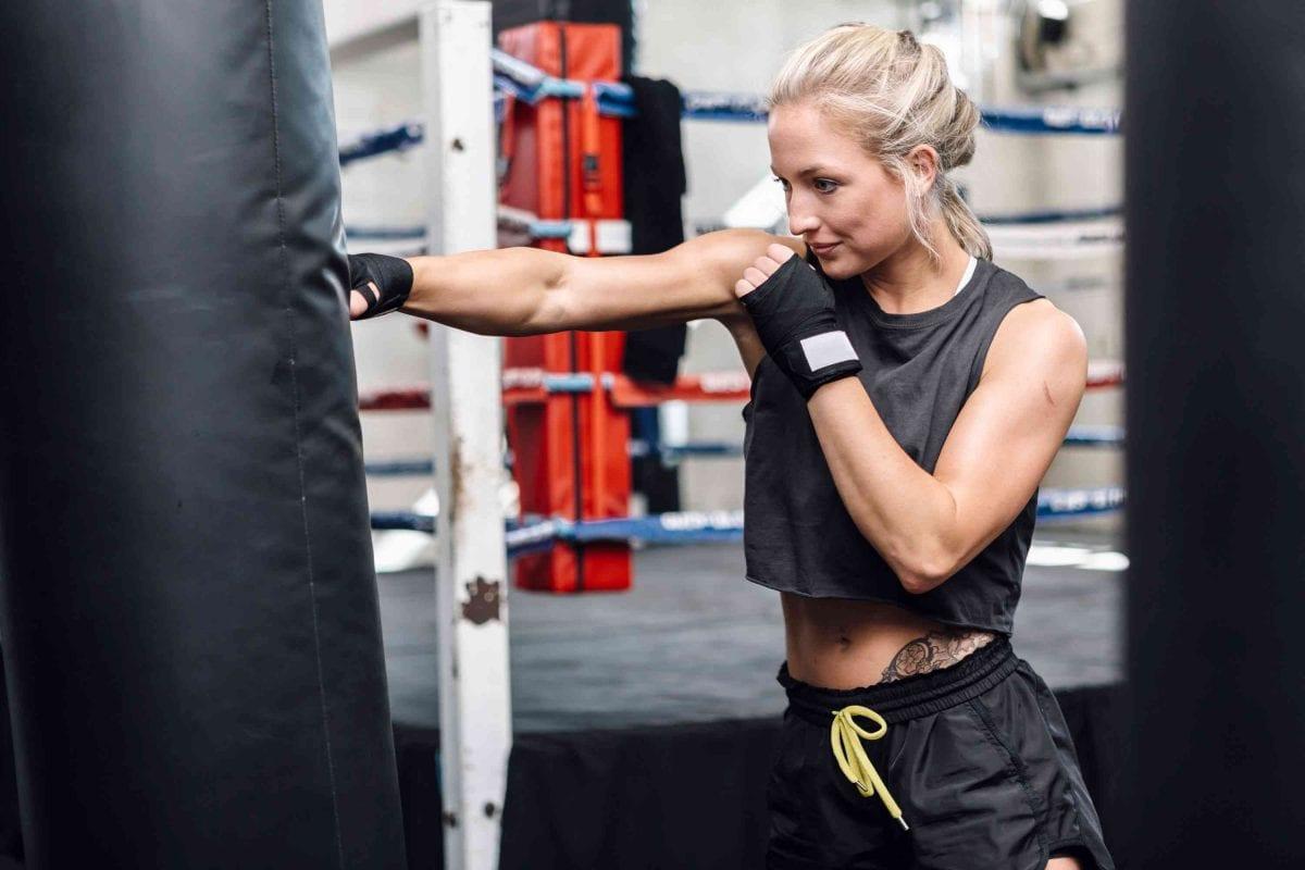 woman hitting a punching bag
