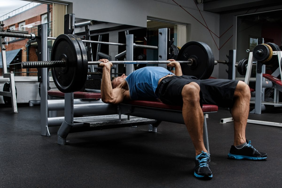 a man doing bench press