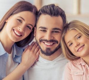 a family smiling for a portrait