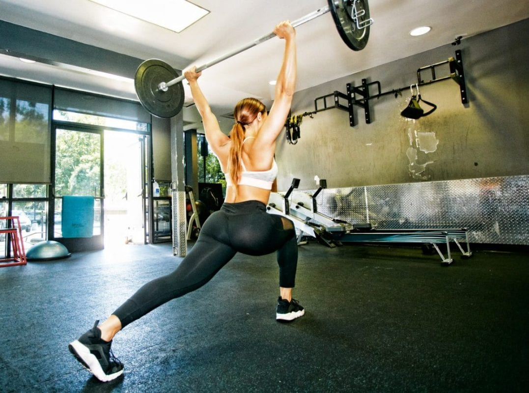 woman doing an overhead lift when working out
